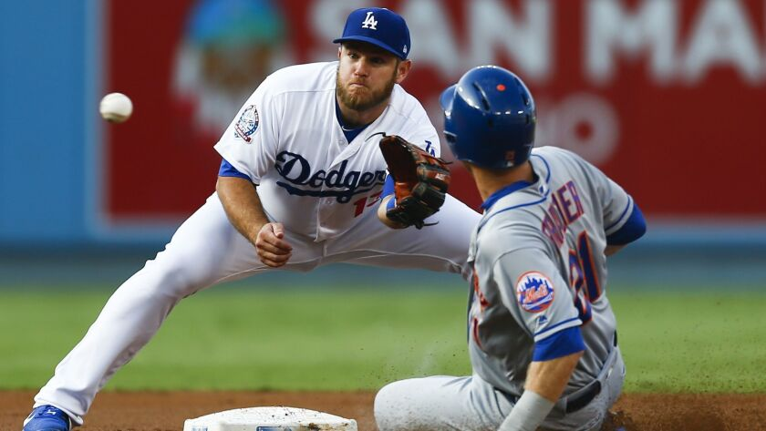 New York Mets third baseman Todd Frazier comes up short trying to steal second base, as Dodgers second baseman Max Muncy forces him out.