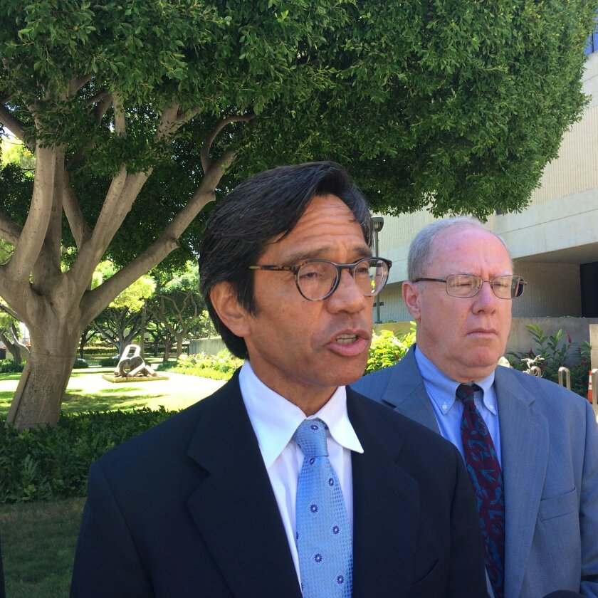 FILE - In a Friday, Oct. 23, 2015 file photo, Bill Meheula, left, an attorney for Nai Aupuni, speaks to reporters outside U.S. District Court in Honolulu. A federal appeals court is allowing a vote count to proceed in an ongoing Native Hawaiian election. The 9th U.S. Circuit Court of Appeals on Thursday, Nov. 19, 2015, rejected an emergency request to stop the votes from being counted once voting ends on Nov. 30. Native Hawaiians are voting to elect delegates for a convention to come up with a self-governance document. (AP Photo/Audrey McAvoy, File)