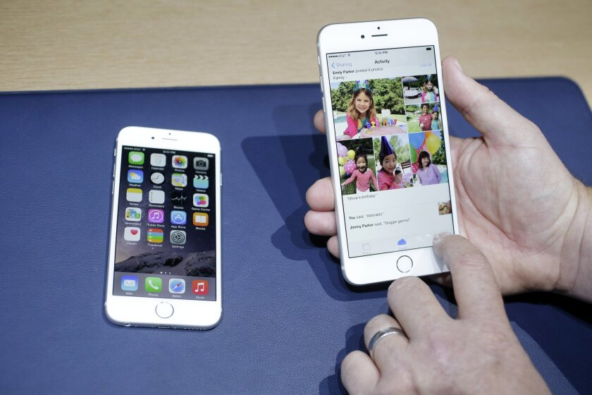 FILE - In this Sept. 9, 2014, file photo, the iPhone 6, at left, and iPhone 6 plus are shown next to each other during a new product release in Cupertino, Calif. Apple's new and bigger iPhone 6 and iPhone 6 Plus are more durable than last year's model and a leading Android phone, a study says. Appl