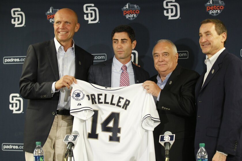 The Padres announced A.J. Preller, second from left, has been named executive vice president/general manager. From left are Padres President & CEO Mike Dee, left, Padres Chairman Ron Fowler, and Peter Seidler.