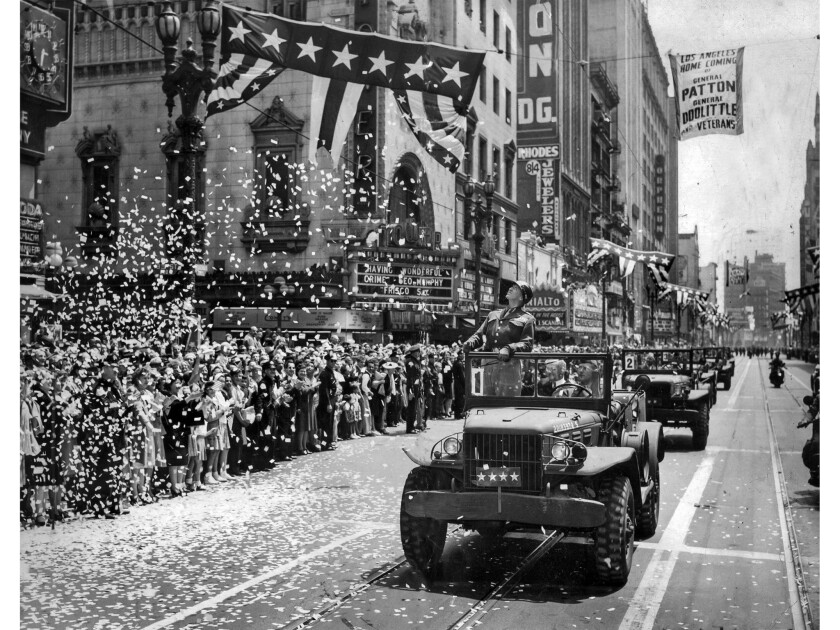 June 9, 1945: Gen. George S. Patton Jr., stands during welcome home procession on Broadway in downto