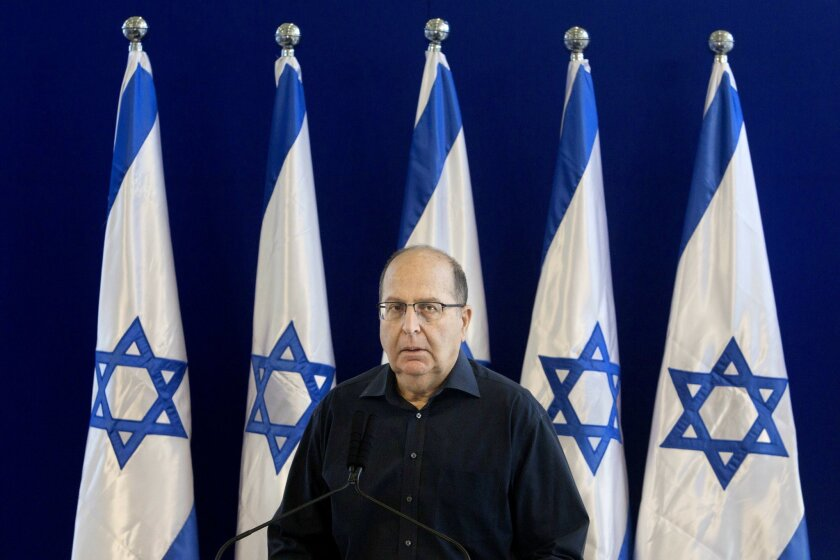 FILE - In this Friday, May 20, 2016 file photo, Israel's Defense Minister Moshe Yaalon, speaks during a press conference at the Defense Ministry in Tel Aviv. Israel's defense minister officially stepped down on Sunday, May 22, 2016 capping a tumultuous week of politics that is expected to result in the replacement of the former military chief with an inexperienced hard-liner in the sensitive post. (AP Photo/Sebastian Scheiner, File)