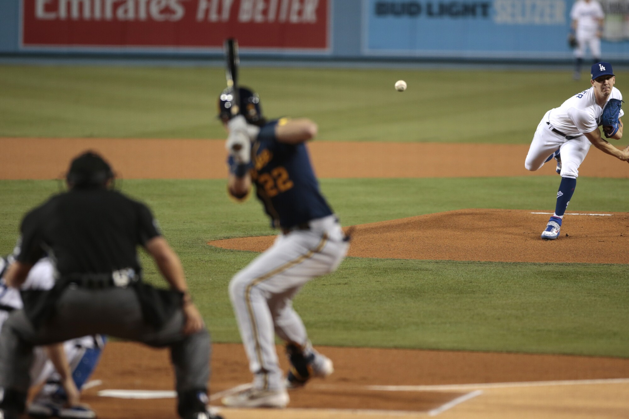 Dodgers pitcher Walker Buehler delivers to Milwaukee Brewers right fielder Christian Yelich.