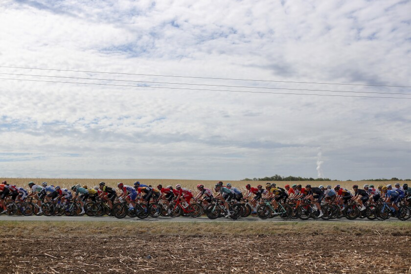 The pack rides during the stage 12 of the Tour de France cycling race over 218 kilometers from Chauvigny to Sarran, Thursday, Sept. 10, 2020. (AP Photo/Thibault Camus)