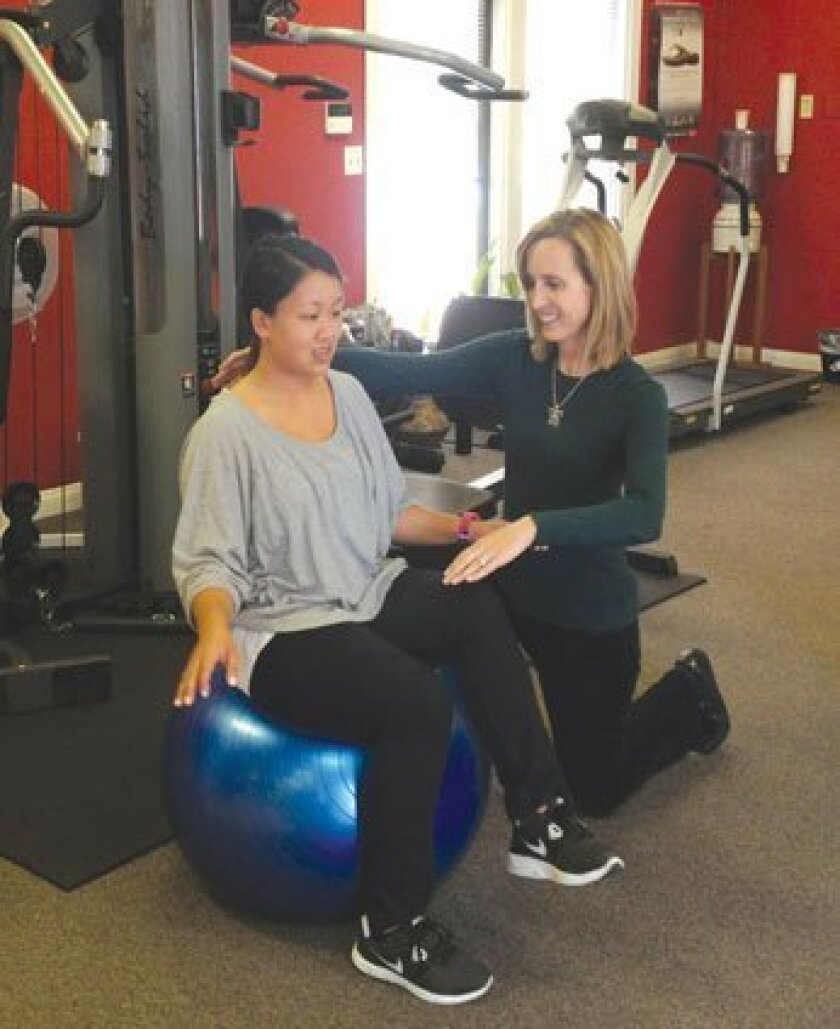 Julie Hom (right) of Ability Rehabilitation Specialists  in La Jolla works with a patient. Courtesy Photo