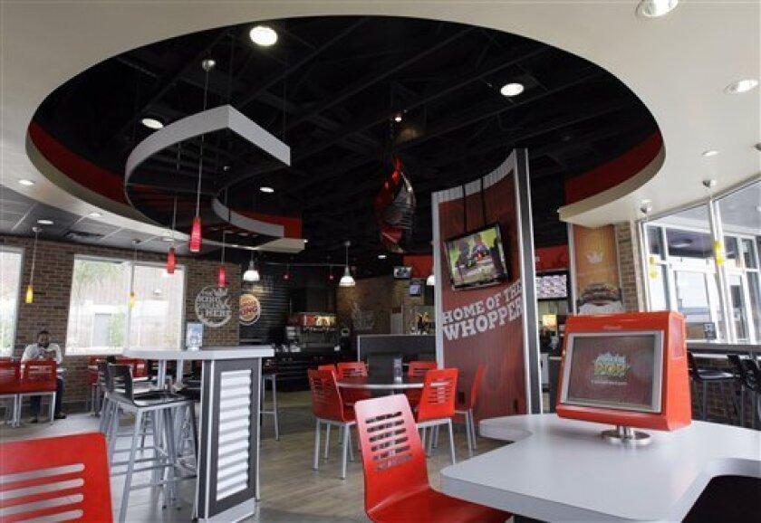 """A Burger King in the Houston suburb of Spring, Texas sports the company's new """"20/20"""" design, Monday, Oct. 5, 2009. (AP Photo/Pat Sullivan)"""