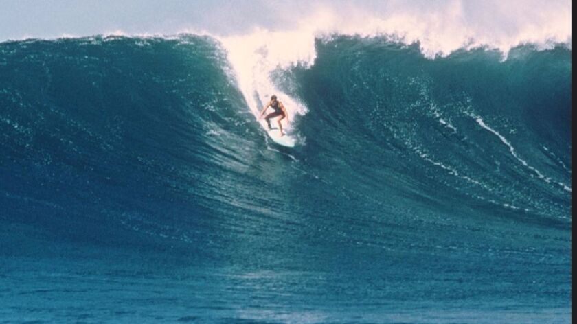 Debbie Beacham is known for surfing big waves. This picture of her was taken at Sunset Beach, Hawaii