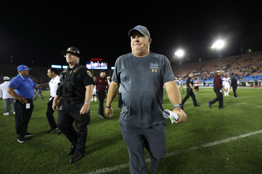 UCLA coach Chip Kelly walks off the field after the win against Arizona State on Saturday at the Rose Bowl.