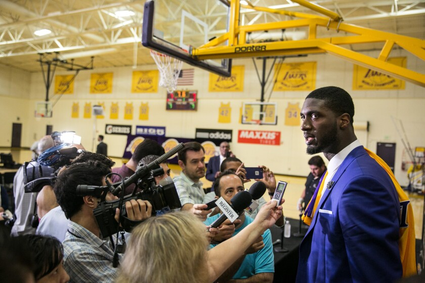 Roy Hibbert is swarmed by reporters after an introductory news conference at the Lakers' training facility in El Segundo.