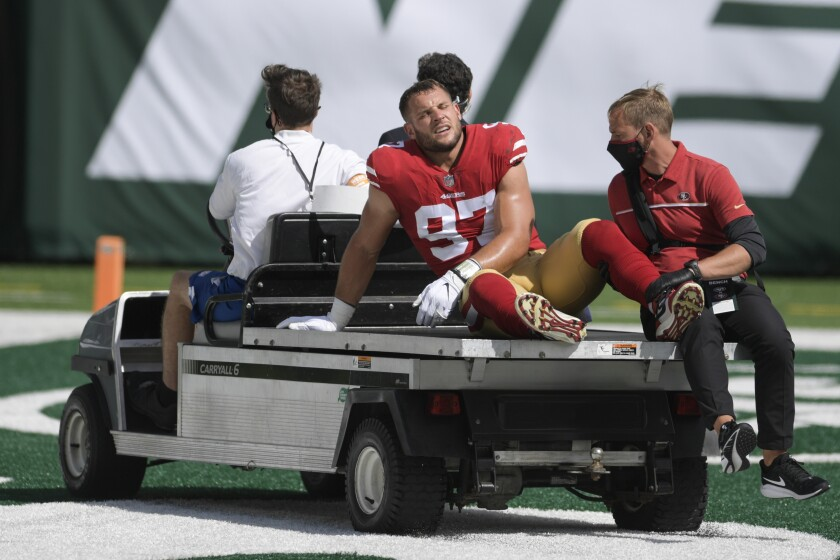 San Francisco 49ers defensive end Nick Bosa is taken off the field after being injured against the New York Jets on Sunday.