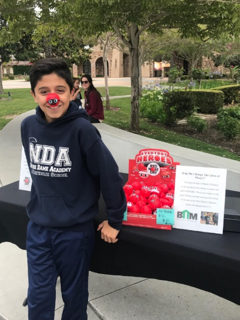 "Gabriel Benitez is helping to raise funds for the nonprofit Build a Miracle organization through the sale of ""red noses."""
