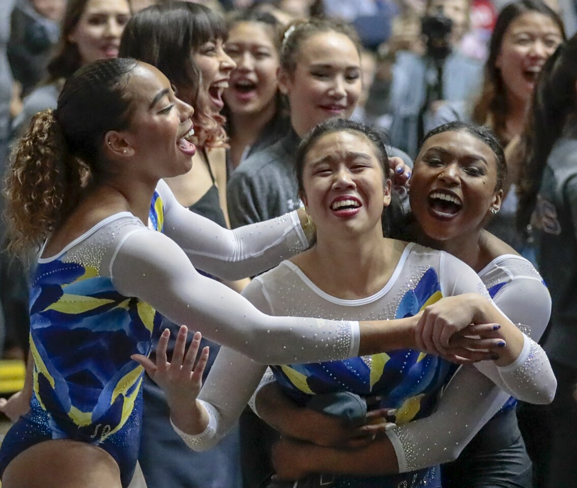 ANAHEIM, CA, SATURDAY, JANUARY 4, 2020 The 2020 UCLA gymnast Samantha Sakti is overcome with emotion after posting a high score on the balance beam at the Collegiate Challenge gymnastics meet at the Anaheim Convention Center. (Robert Gauthier/Los Angeles Times)