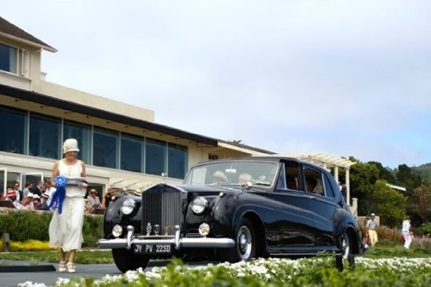Presentation of a first-place ribbon to Ken and Ann Smith's 1961 Rolls-Royce at the Pebble Beach Concours (Courtesy Photos)