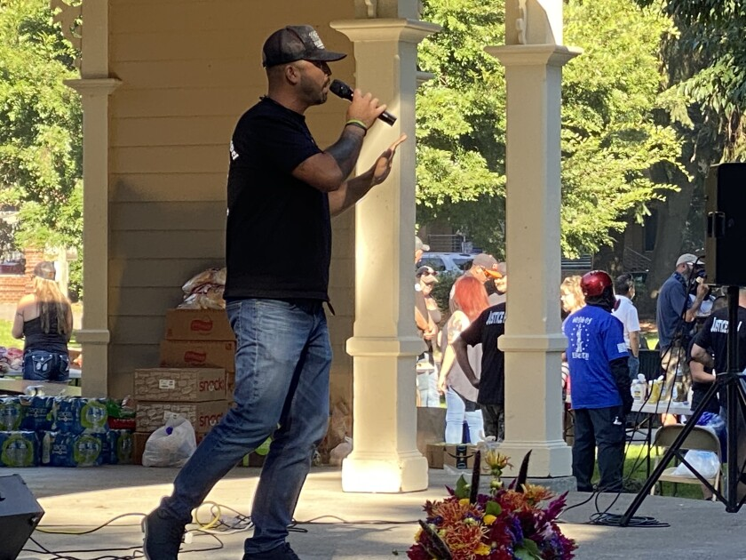 "Patriot Prayer leader Joey Gibson speaks in Vancouver, Wash., at a memorial for slain follower Aaron ""Jay"" Danielson."