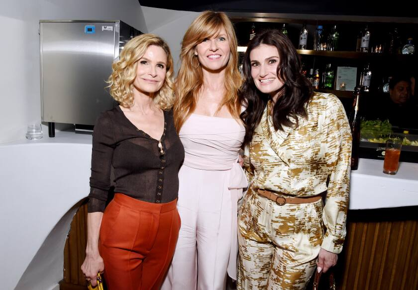 Kyra Sedgwick, from left, Connie Britton and Idina Menzel attend Women in Film's 13th annual Oscar nominees party at the Sunset Room in Hollywood on Friday.
