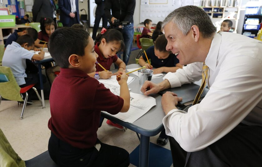 Education Secretary Arne Duncan visits with students in Denver in May.