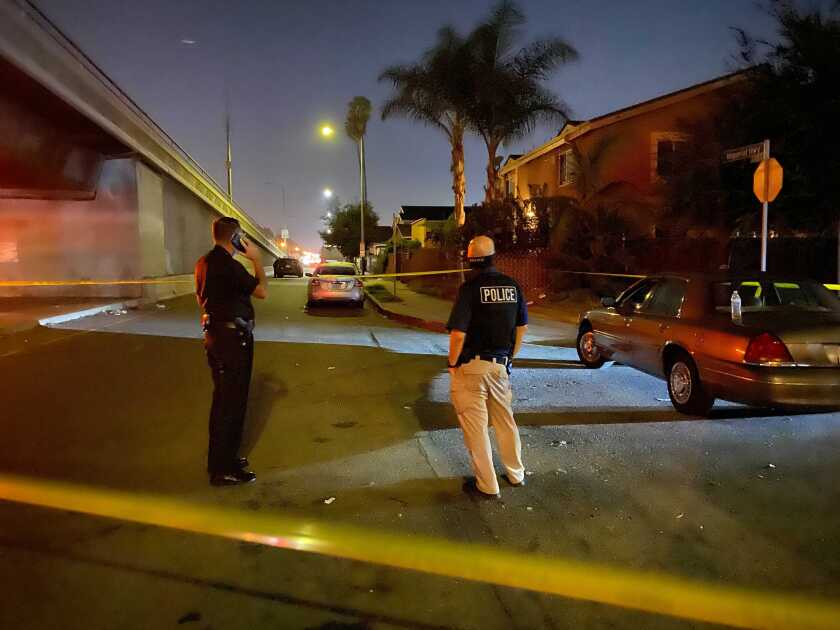 Police tape surrounds the spot where a 17-year-old boy was fatally shot in South Los Angeles.