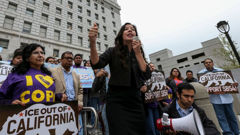 Alejandra Valles of SEIU addresses supporters of state sanctuary bill SB 54 at rally held outside the Hall of Justice against Sheriff Jim McDonnell who is opposing the bill.