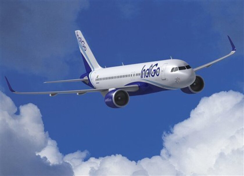 "FILE - This file computer image provided by Airbus Jan. 12, 2011, shows a A320neo jet. Airbus said Wednesday, June 22, 2011, Indian low-cost carrier IndiGo has ordered 180 aircraft, including 150 of its new A320neo fuel saving jets, in what it calls ""the biggest order in aviation history.""(AP Photo/Airbus, file)"