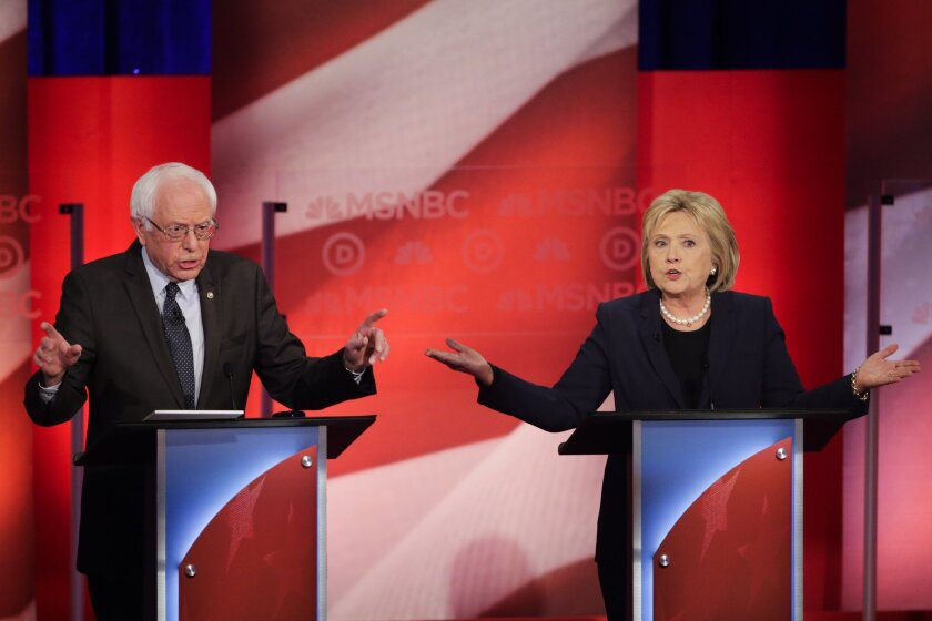 Democratic presidential candidates Sen. Bernie Sanders and former Secretary of State Hillary Clinton spar during a Feb. 4 debate in Durham, N.H.