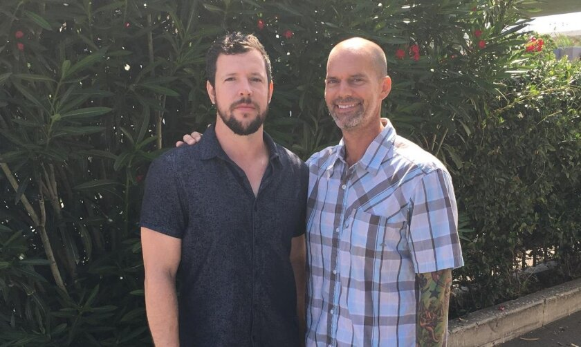 """Encinitas filmmaker Brian Mahoney, right, made the award-winning short film """"26th and Logan"""" chronicling the making of a piece of artwork by his friend Josh Hunter, left."""