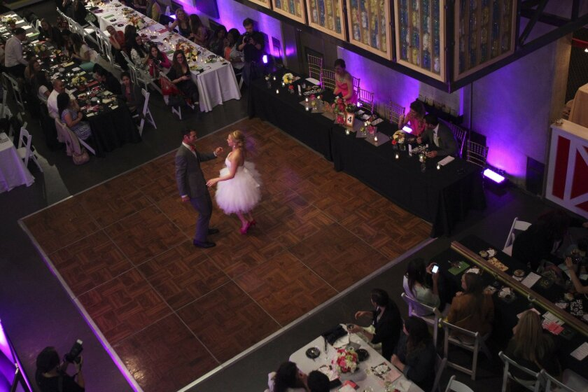 Happy Not Wedding couple Richard and Dannielle Balcazar dance their first dance as the ticket-buying guests look on.