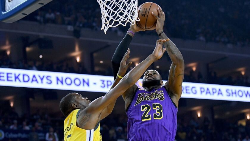 Lakers forward LeBron James, drawing a foul from Warriors forward Kevin Durant on Christmas, is putting up MVP numbers again this season.