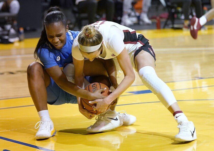 UCLA's Charisma Osborne, left, and Stanford's Lexie Hull vie for the ball in Santa Cruz, Calif., on Jan. 22, 2021.
