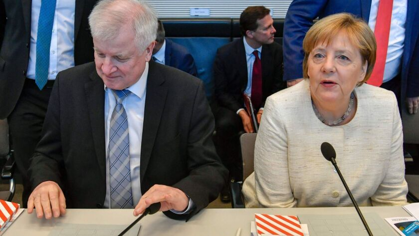 German Chancellor Angela Merkel and German Interior Minister Horst Seehofer attend a meeting in Berlin on Tuesday.