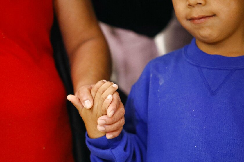 Darwin Micheal Mejia, right, holds hands with his mother, Beata Mariana de Jesus Mejia-Mejia, during a news conference following their reunion at Baltimore-Washington International Thurgood Marshall Airport, Friday, June 22, 2018, in Linthicum, Md.