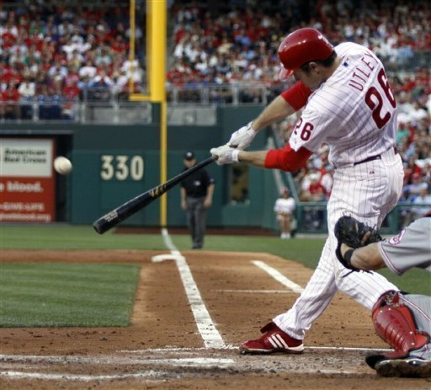 Philadelphia Phillies' Chase Utley hits a solo, in the park, home run against the Cincinnati Reds' during the third inning of a baseball game, Thursday, July 9, 2009, in Philadelphia. (AP Photo/H. Rumph Jr.)