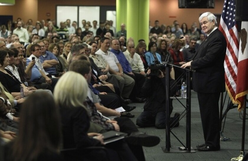 Newt Gingrich talks to employees at an insurance company in Des Moines on Thursday.