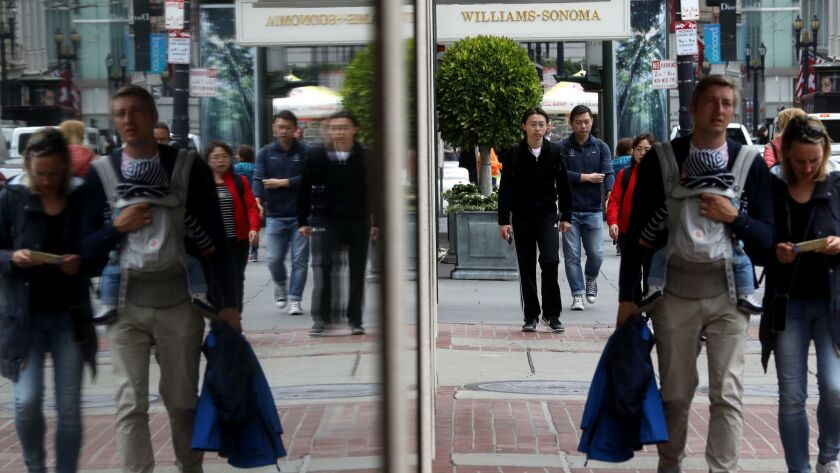 Pedestrians walk along Post Street in San Francisco. The city became the first in the United States to ban facial recognition technology by police and city agencies.