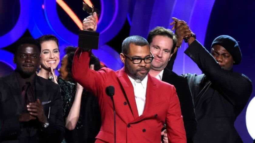 """Get Out"" writer-director Jordan Peele accepts the award for best feature Saturday at the 33rd Film Independent Spirit Awards in Santa Monica."