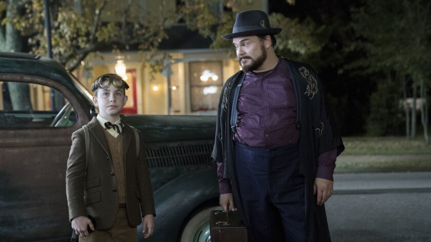 """(L to R) OWEN VACCARO and JACK BLACK star in """"The House with a Clock in Its Walls,"""" from Amblin Ente"""