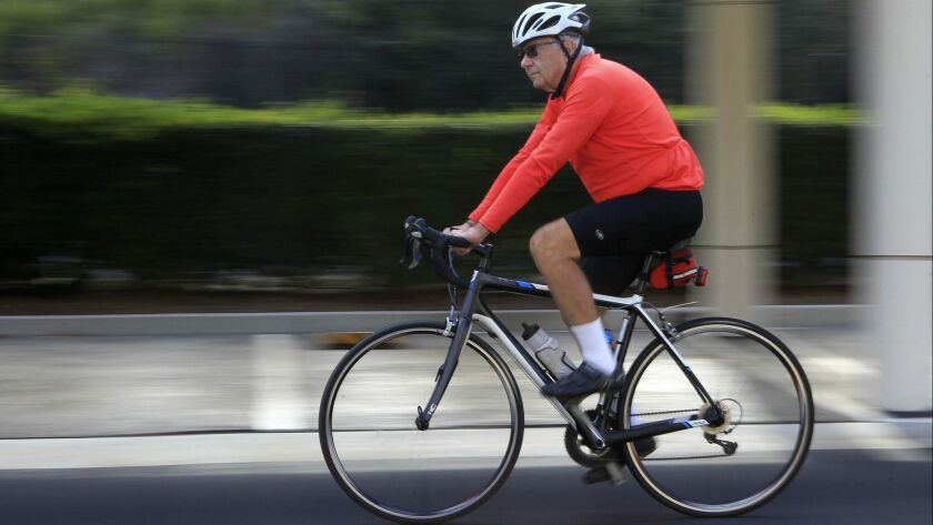 Dr. Daniel Marks, 78, taking one of his 22 bicycles out for a spin in his Carlsbad neighborhood.