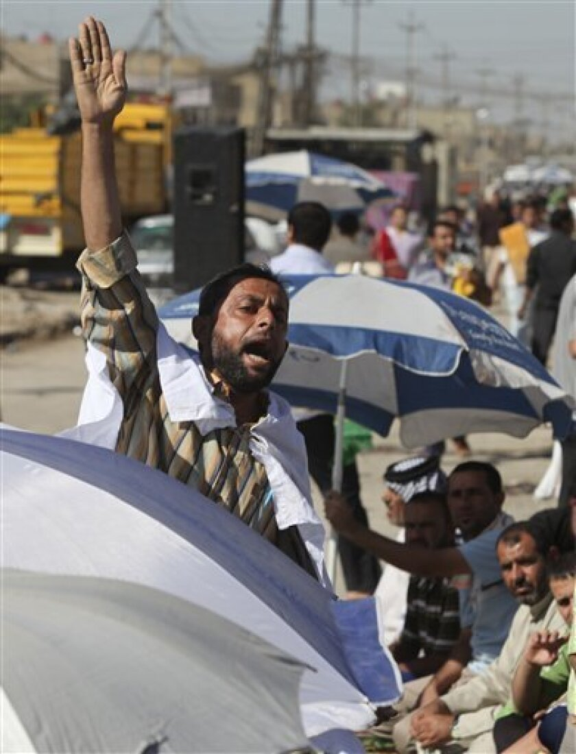 An Iraqi man chants anti-U.S. slogans as followers of radical Shiite cleric Muqtada al-Sadr attend open air Friday prayers in the Shiite stronghold of Sadr City in Baghdad, Iraq, Friday, Nov. 5, 2010. (AP Photo/Karim Kadim)