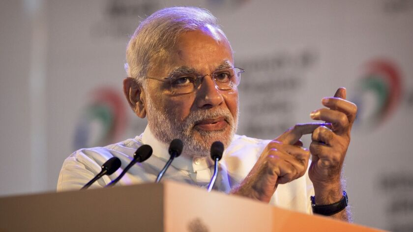 Indian Prime Minister Narendra Modi gestures with a cell phone during the launch of a digital India project in 2015.