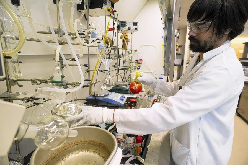 Darryl Kato works on a hepatitis treatment at Gilead Sciences Inc.'s lab in Foster City, Calif., in 2012.