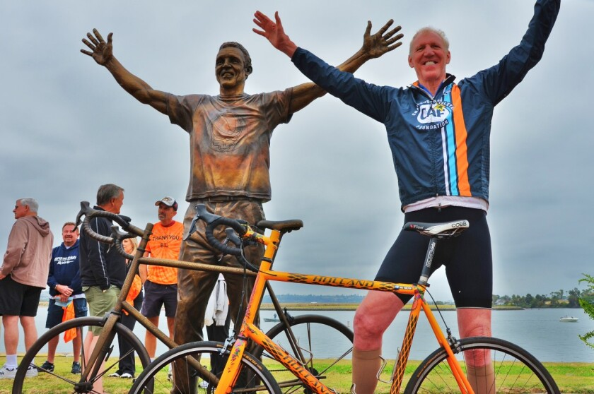 Former basketball star and colorful ESPN personality Bill Walton stands next to his bronze likeness. The cycling enthusiast is inviting people to take part in a Bike for Humanity solo ride event between 9 and 11 a.m. April 25 to benefit several COVID-19-related charities.