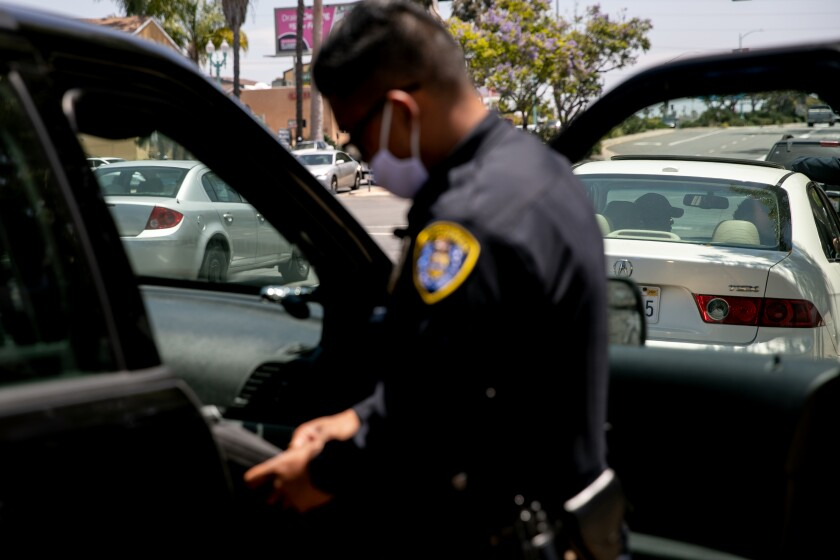 San Diego Police Department officers make a traffic stop along El Cajon Boulevard on June 23, 2020 in San Diego.