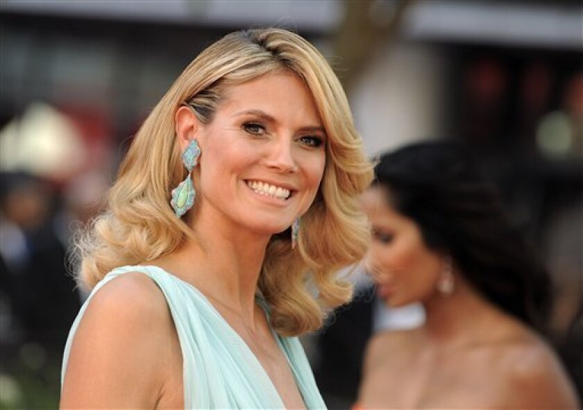 """FILE - This Sept. 23, 2012 file photo shows model Heidi Klum arriving at the 64th Primetime Emmy Awards at the Nokia Theatre in Los Angeles. NBC says Klum has been added to """"America's Got Talent"""" as its fourth judge. The network announced Monday, March 4, 2013, that Klum will join fellow incoming judge Mel B this summer for the talent competition's eighth season. Howie Mandel and Howard Stern will be back at the judges' panel.(Photo by Jordan Strauss/Invision/AP, File)"""