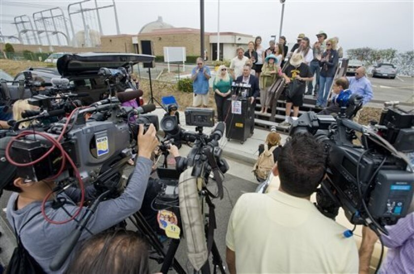 Area activists gather for a news conference outside the San Onofre Nuclear Generating Station in San Clemente, Calif., Friday morning, June 7, 2013, after it was announced that the nuclear plant will be closing permanently. (AP Photo/The Orange County Register, Mark Rightmire)   MAGS OUT; LOS ANGEL