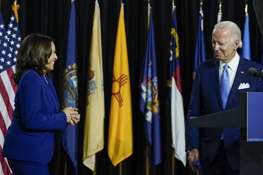 Sen. Kamala Harris joins Joe Biden on stage in Wilmington, Del., on Wednesday.