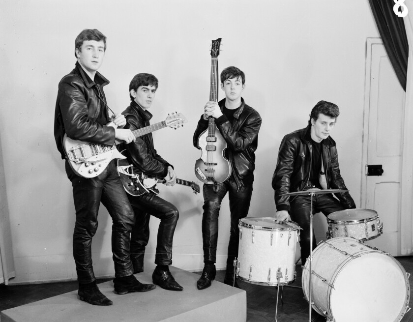 """The Beatles in leather suits. An image from the book """"Tune In: The Beatles: All These Years,"""" by Mark Lewisohn."""