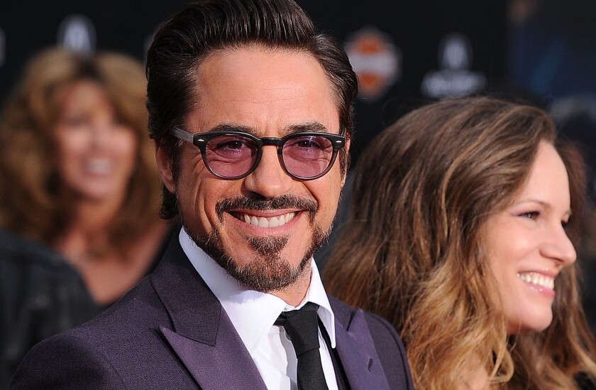 "Robert Downey Jr. with wife Susan at the 2012 premiere of ""The Avengers."" The actor tops Forbes' 2014 list of Hollywood's highest-paid actors."