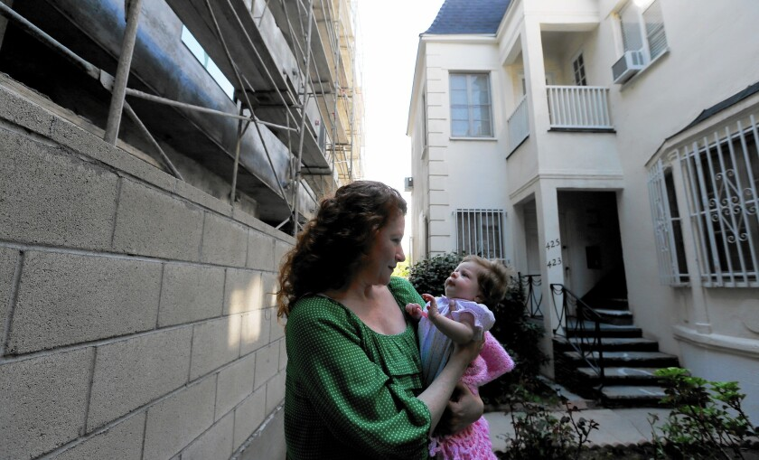 Dee Ann Newkirk and her newborn daughter live in a fourplex that was purchased last year.