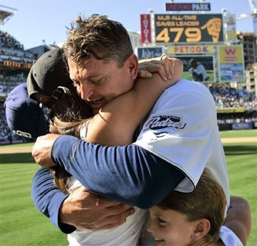 SEPT. 24, 2006: Trevor Hoffman hugged his wife, Tracy, and son Quinn after he earned his 479th save,  passing Lee Smith as the all-time leader. (K.C. Alfred / Union-Tribune file)