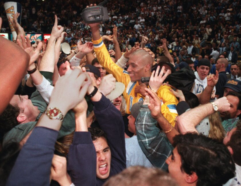Charles O'Bannon celebrates UCLA's victory over Oregon in the Pac-10 tournament final on March 11, 1995.
