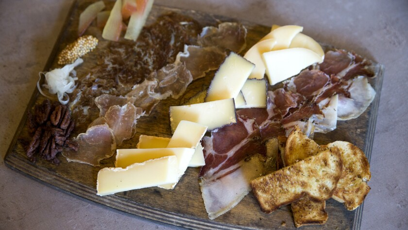 A board of cured meat, brioche bread, and cheese, all made at Scratch Bar & Kitchen in Encino.